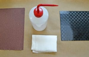 Sandpaper, solvent, and composite.