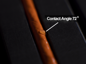 orange-wire-curved-surface-water-drop-contact-angle-72-degrees