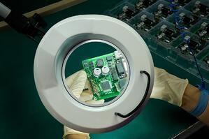 hands-handling-printed-circuit-board-inspection-under-magnifying-glass-close-up-electronics-ebook